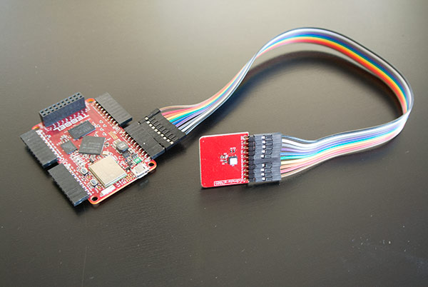 Tessel with weather module attached via jumper wires